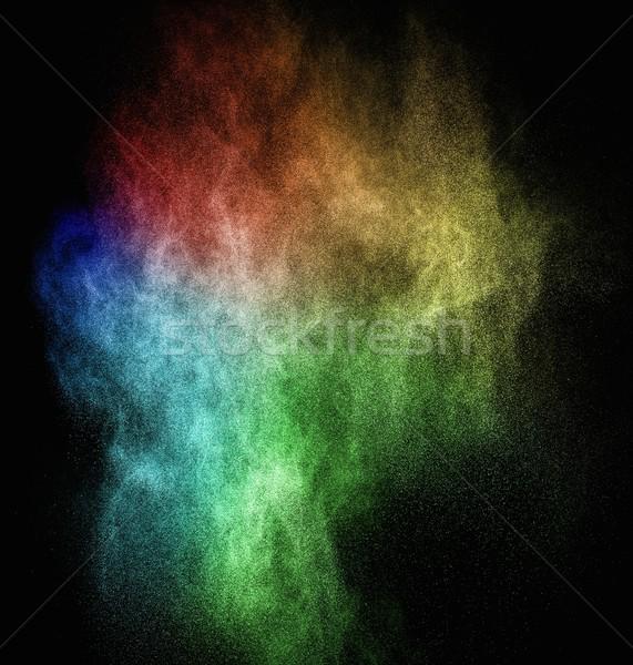 Colourful powder exploding isolated on black Stock photo © Nejron