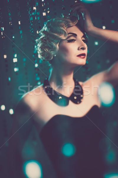 Elegant blond retro woman with beautiful hairdo  Stock photo © Nejron