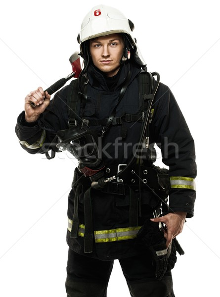 Young firefighter with helmet and axe isolated on white  Stock photo © Nejron