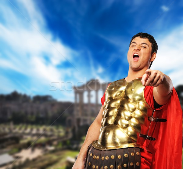 Legionary soldier in front of old city Stock photo © Nejron