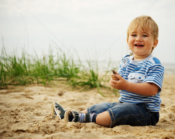 Cute little baby playing on a beach. Stock photo © Nejron