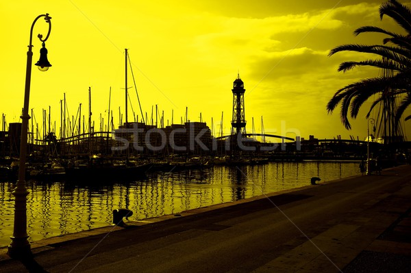 ストックフォト: 黄色 · 空 · 水 · 日没 · ボート · ケーブル
