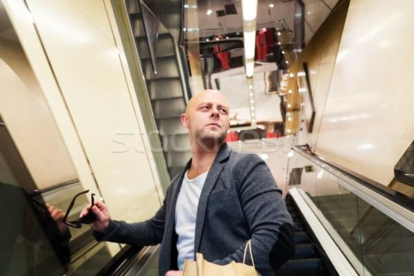 男 ショッピングバッグ エスカレーター ビジネス ストックフォト © Nejron