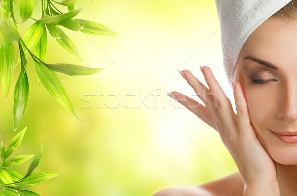 Beautiful young woman applying organic cosmetics to her skin Stock photo © Nejron