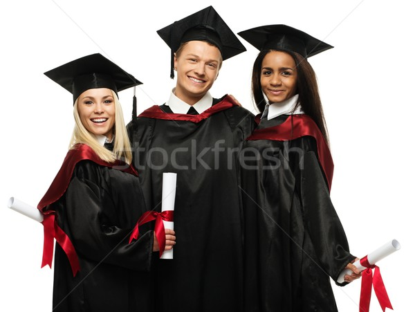 Multi ethnic group of graduated young students isolated on white Stock photo © Nejron