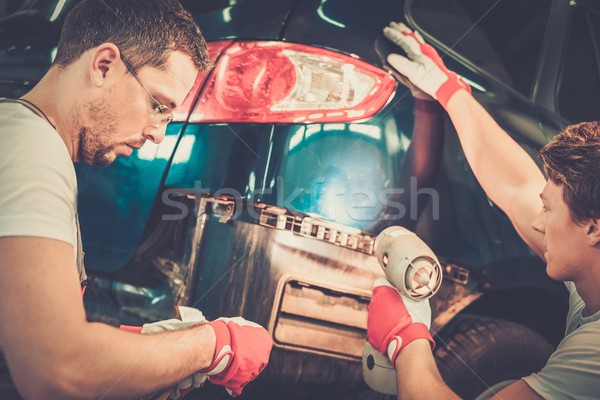 Two workers with colour samples choosing correct tone in a car body workshop  Stock photo © Nejron