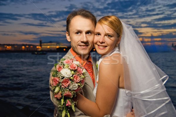Just married couple near the river at sunset time Stock photo © Nejron
