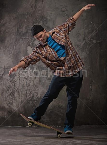 фигурист трюк стены джинсов подростков Skate Сток-фото © Nejron