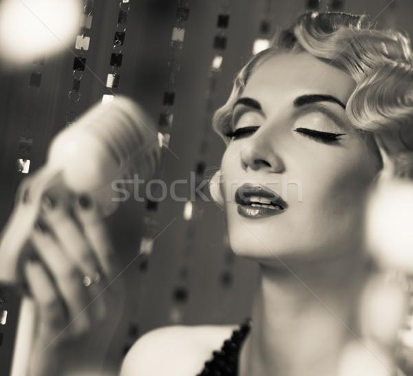 Monochrome portrait of elegant blond retro woman singer with beautiful hairdo  Stock photo © Nejron