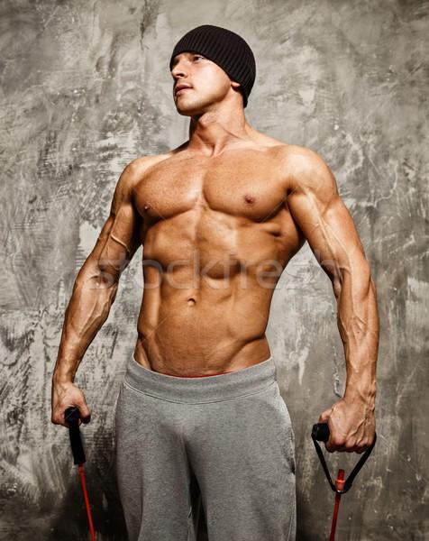 ハンサムな男 筋骨たくましい体 フィットネス 行使 健康 ジム ストックフォト © Nejron
