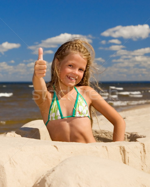 Stock photo: Happy little girl near the sea