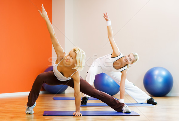 Group of people doing fitness exercise Stock photo © Nejron