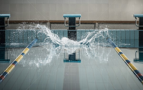 Splashes after swimmers jump in a swimming pool  Stock photo © Nejron