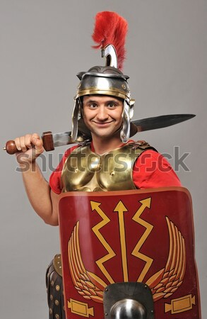 Handsome legionary soldier with a gladius Stock photo © Nejron