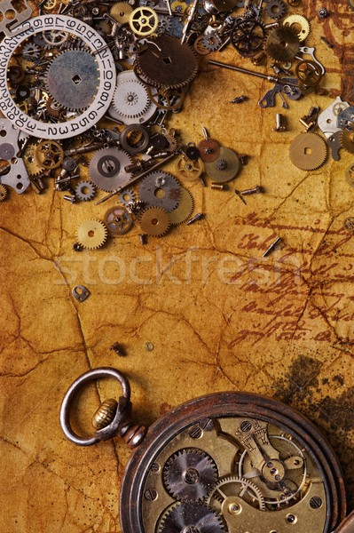 The old gears on the textured paper Stock photo © Nejron