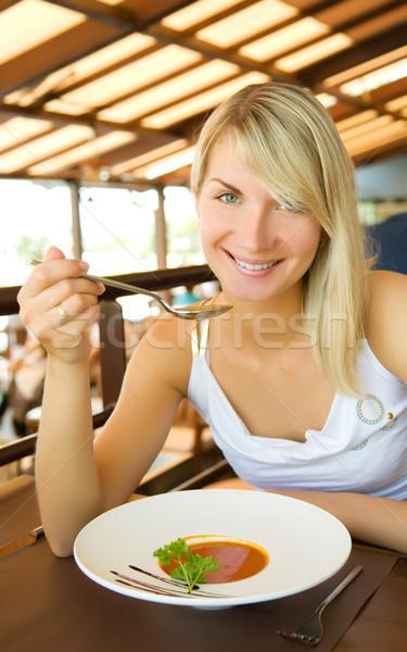 Młoda kobieta jedzenie zupa pomidorowa restauracji piękna portret Zdjęcia stock © Nejron