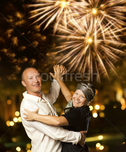 Middle-aged couple dancing waltz at night    Stock photo © Nejron