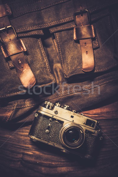 Vintage camera and handbag on wooden background  Stock photo © Nejron