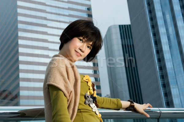 Hermosa chino mujer aire libre ciudad Foto stock © Nejron