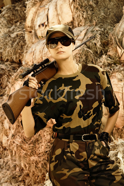 Beautiful woman soldier with a sniper rifle Stock photo © Nejron