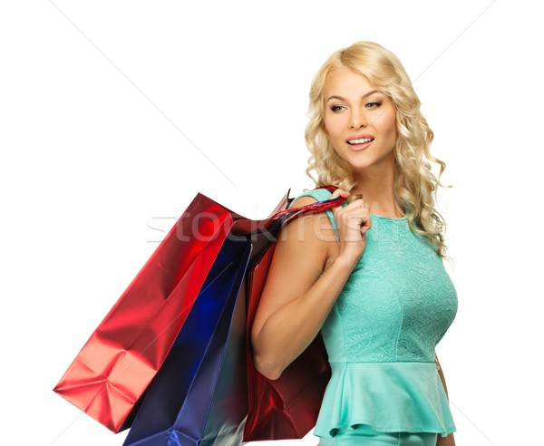 Smiling young blond woman with shopping bags Stock photo © Nejron