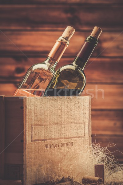 Bottle of red and white wine in wooden box Stock photo © Nejron
