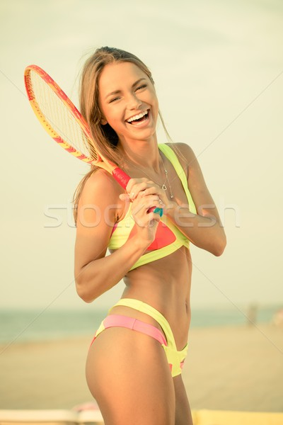 Young girl in swimming suit on a beach with racquet  Stock photo © Nejron