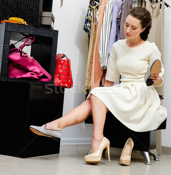 Young woman choosing shoes in a showroom  Stock photo © Nejron