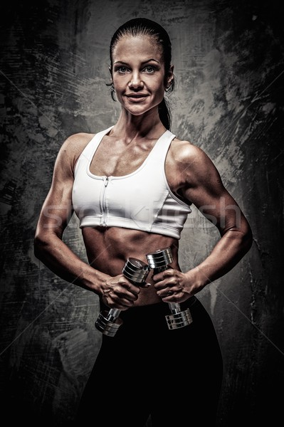 Beautiful athletic woman  with dumbbells Stock photo © Nejron