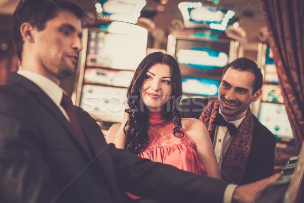 Mensen casino vrouw geld gelukkig Stockfoto © Nejron