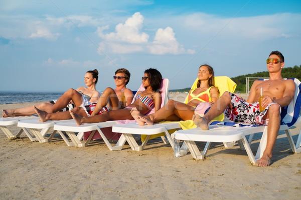 Csoport többnemzetiségű barátok napozás fedélzet székek Stock fotó © Nejron