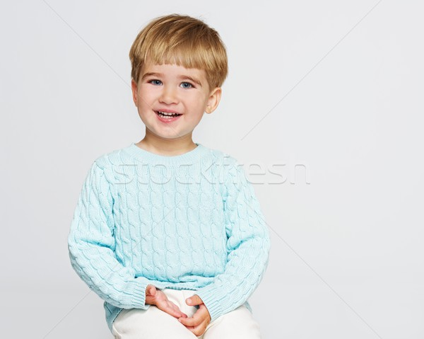 Smiling baby boy in blue pullover Stock photo © Nejron