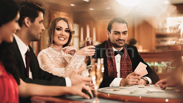 Group of young people playing poker in a casino Stock photo © Nejron