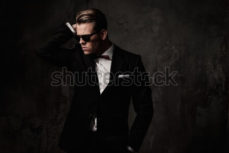 Stylish young man in black coat and sunglasses Stock photo © Nejron