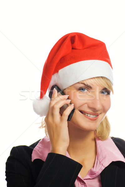 Business woman in Christmas hat talks on the phone. Isolated on  Stock photo © Nejron