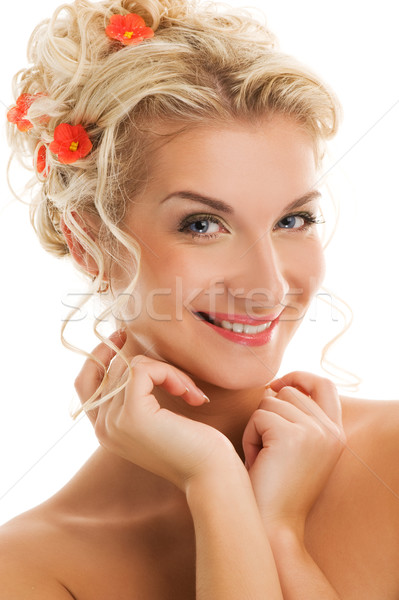 Beautiful young woman with fresh spring flowers in her hair clos Stock photo © Nejron