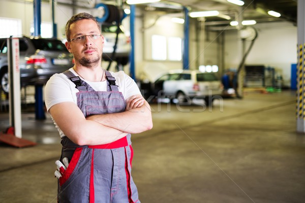 Serviceman in a car workshop Stock photo © Nejron