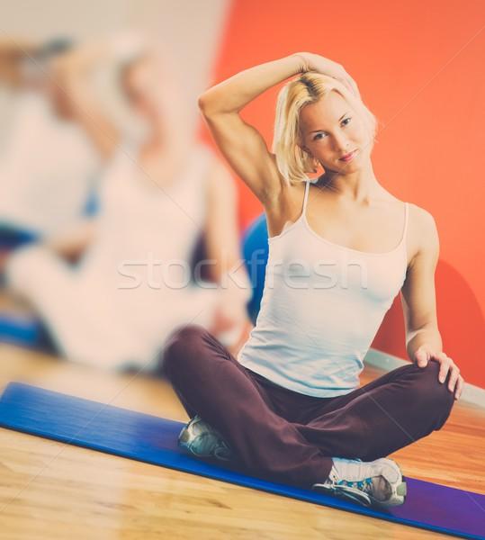 Group of people doing yoga exercise Stock photo © Nejron
