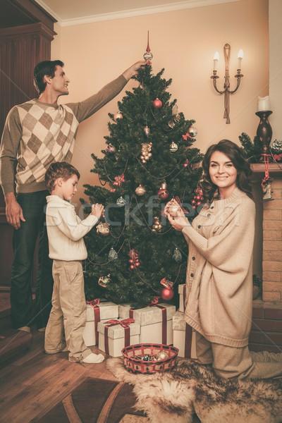 Happy family decorating Christmas tree  Stock photo © Nejron