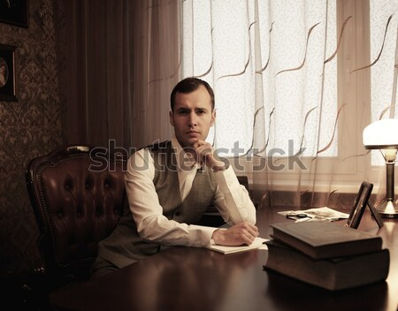 Angry businessman rumples a documents Stock photo © Nejron
