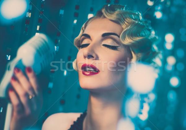 Elegant blond retro woman singer with beautiful hairdo and red lipstick Stock photo © Nejron