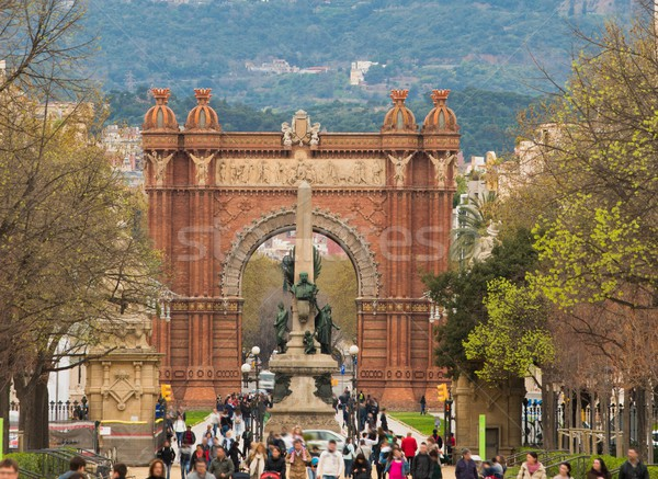 People walking against Triumph Arc in Barcelona, Spain Stock photo © Nejron