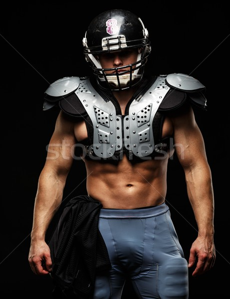 American football player wearing helmet and protective armour  Stock photo © Nejron