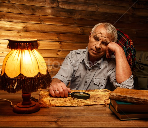 Senior man with magnifier fell asleep in homely wooden interior  Stock photo © Nejron