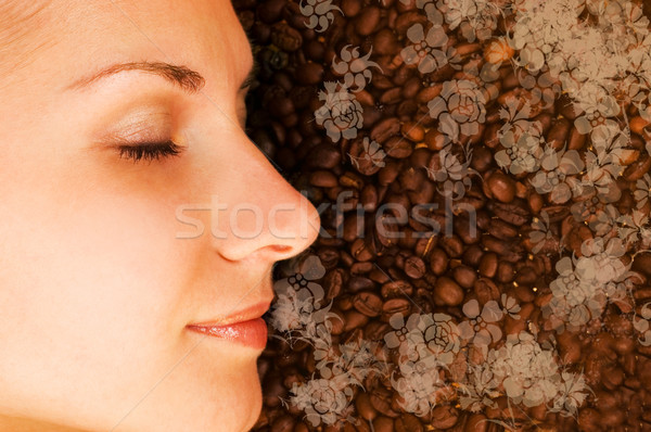 Beautiful girl breathing in scent of coffee Stock photo © Nejron