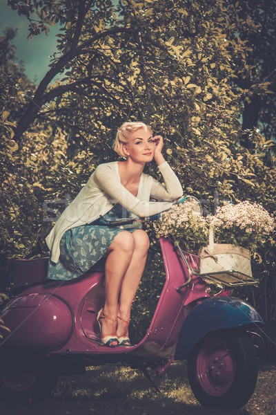 Beautiful blond woman sitting on a retro roller  Stock photo © Nejron