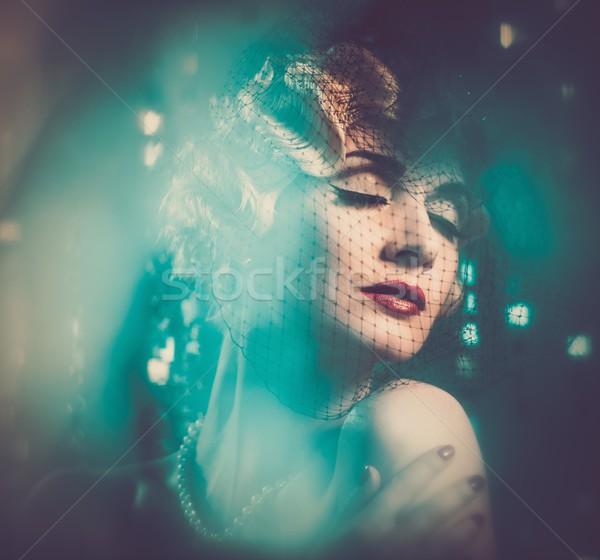 Elegant blond retro woman in veil with beautiful hairdo  Stock photo © Nejron