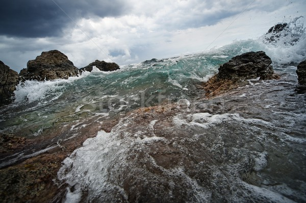 Big ocean wave breaking the rocks Stock photo © Nejron