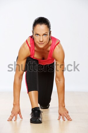 Stock photo: Beautiful athlete woman exercising in fitness club.