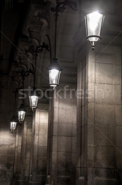 Facade of building with columns and lanterns Stock photo © Nejron